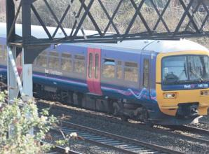 Rail service cuts plan criticised by Theresa May MP