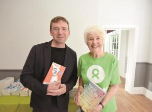 Oxfam coffee morning attended by prominent author raises hundreds