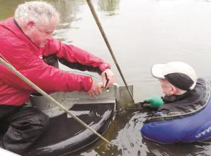 Volunteers get chest-deep in water to repair Green Lane weir