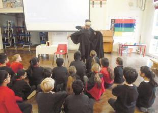 Judge swaps court for St Luke's Primary School classroom