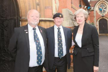 Theresa May attends service to commemorate those who died in the Battle of the Somme