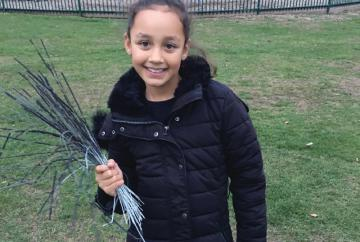 Girl collects dozens of discarded sparklers