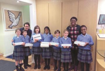 Global tech company donates iPads to prep school