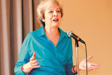 Theresa May backs call for business rates relief to be extended to local publishers